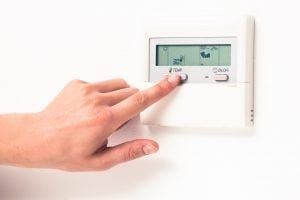 Digital thermostat being used