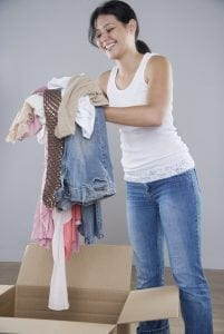 Girl getting clothes ready for a storage near university of miami